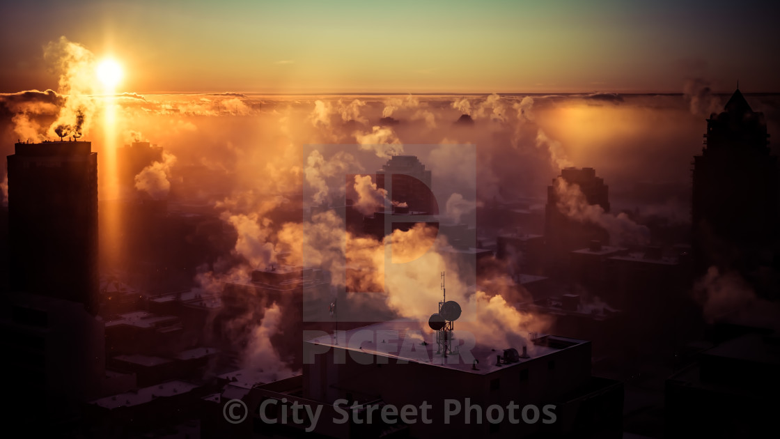 """Sunrise over a cityscape"" stock image"