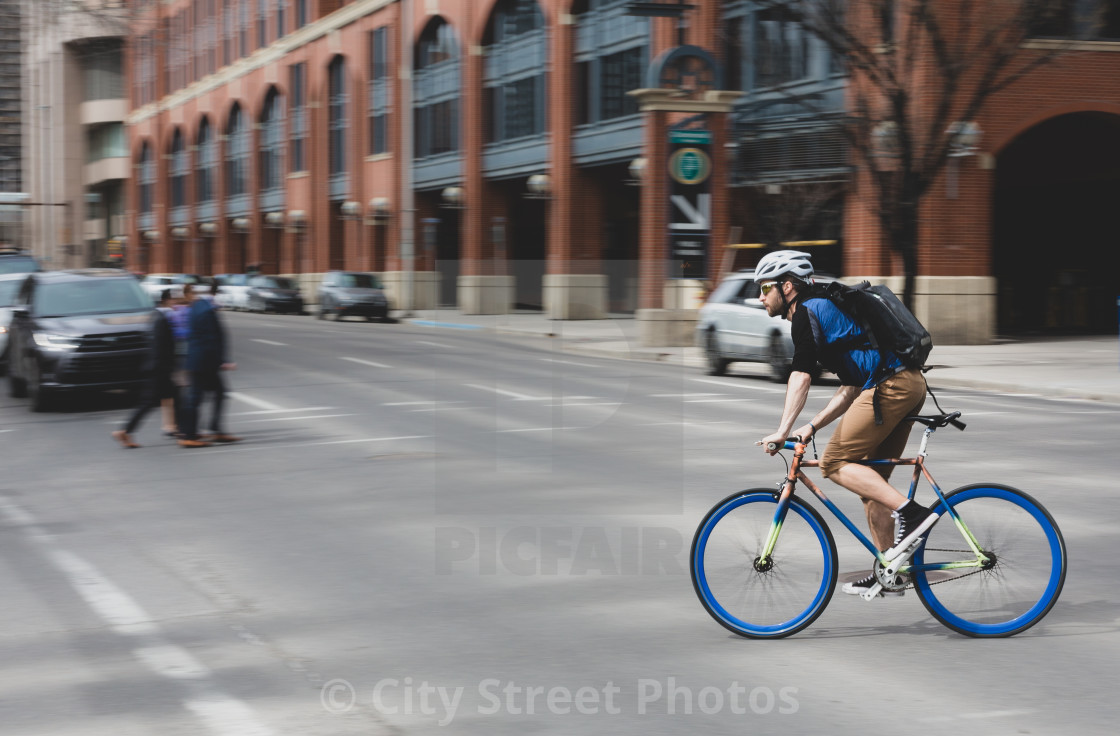 """Man riding fast on a mountain bike"" stock image"
