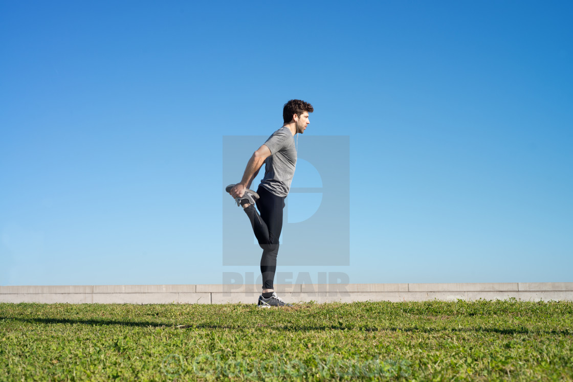 """""""man stretches the leg before running space for text"""" stock image"""