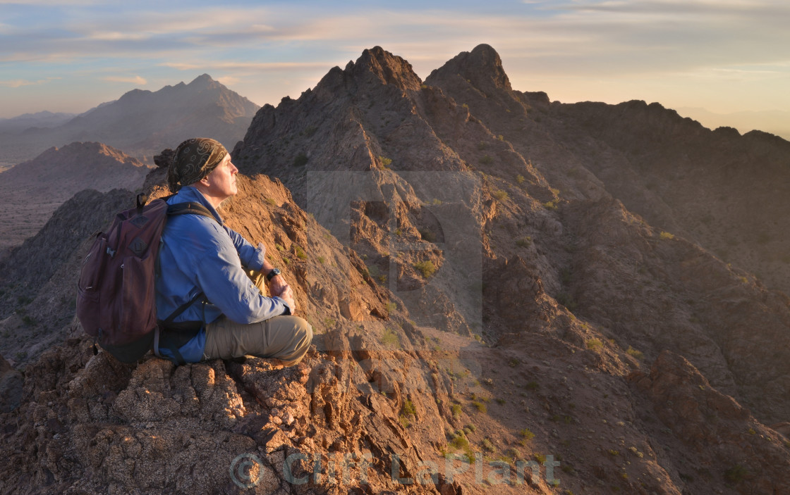 """Climber on the Summit at Sunset"" stock image"