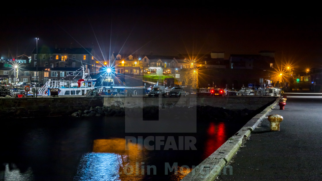 """Seahouses Harbour at Night"" stock image"