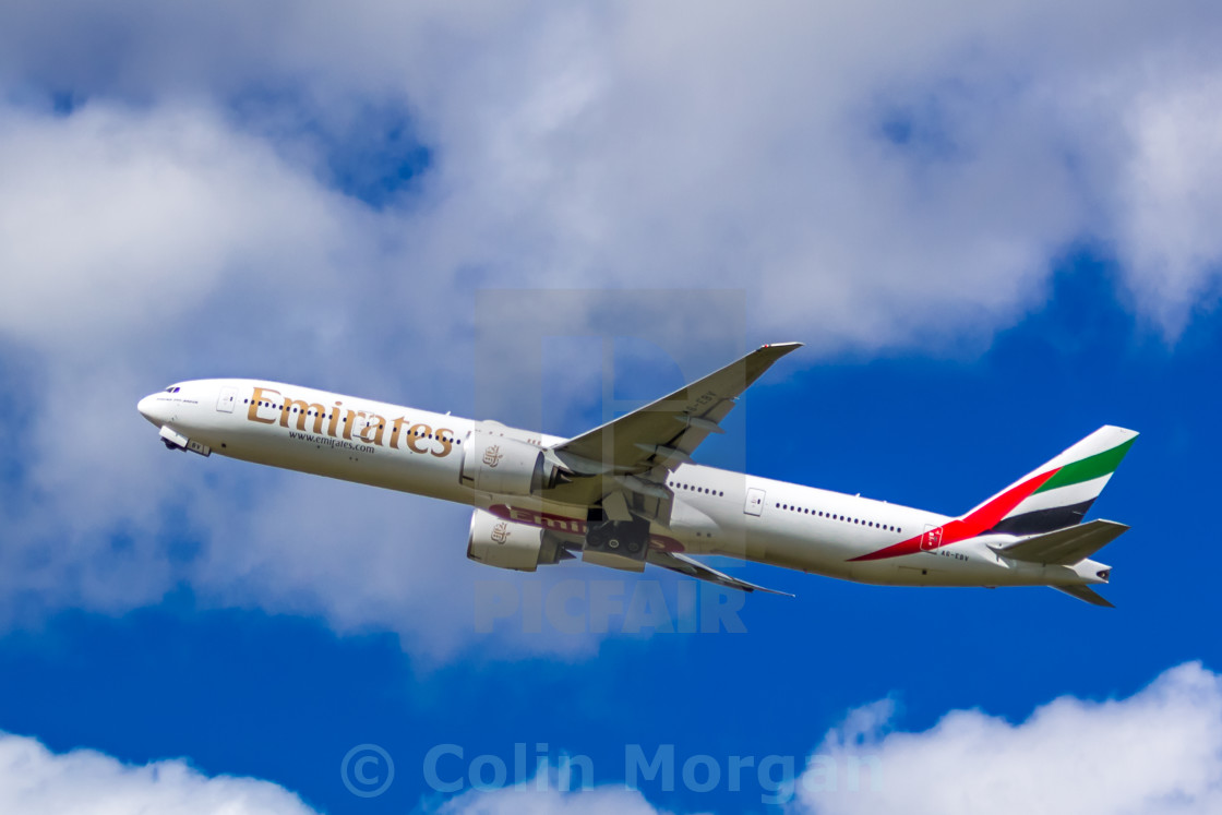 """Emirates Boeing 777 departing Newcastle Airport"" stock image"