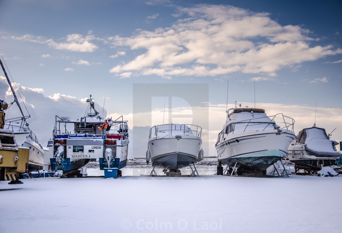 """Snow in the boatyard"" stock image"