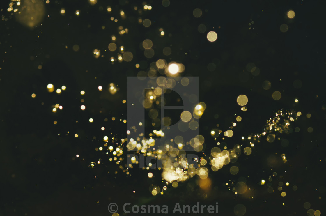 """magical golden sparkles, abstract glitter dark background"" stock image"