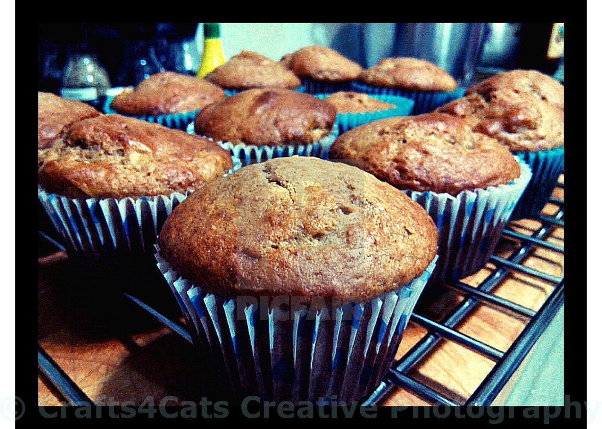"""""""Tasty Apple Muffins in Blue Cups"""" stock image"""