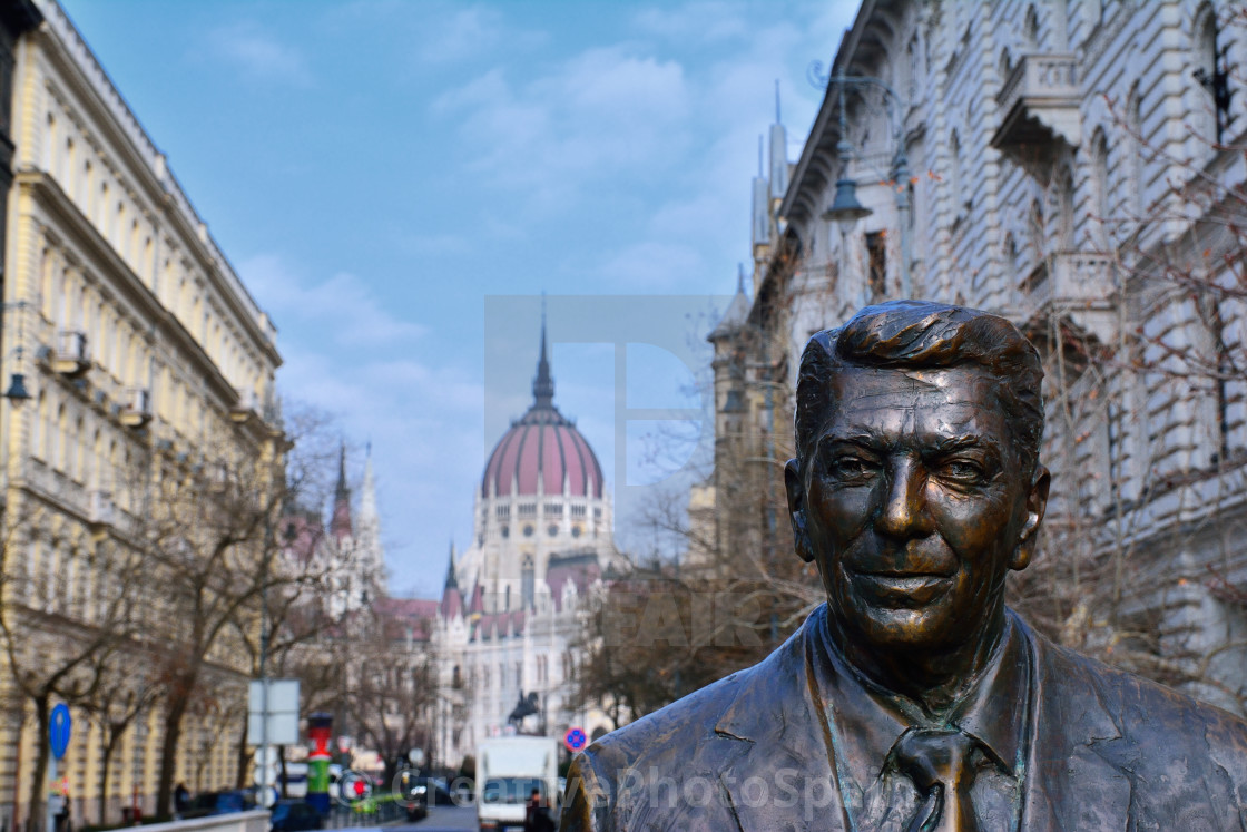 """Statue of the former U.S. President Ronald Reagan on the background of Hungarian Parliament Building."" stock image"