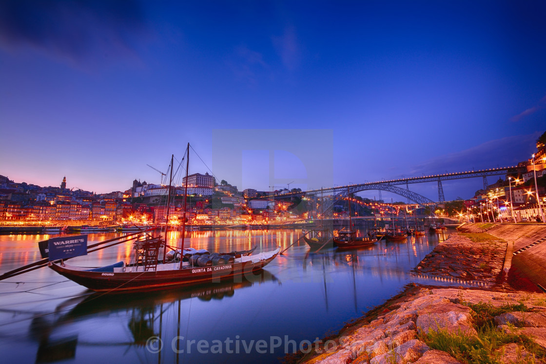 """Porto, old town skyline with the Douro river and rabelo boats."" stock image"