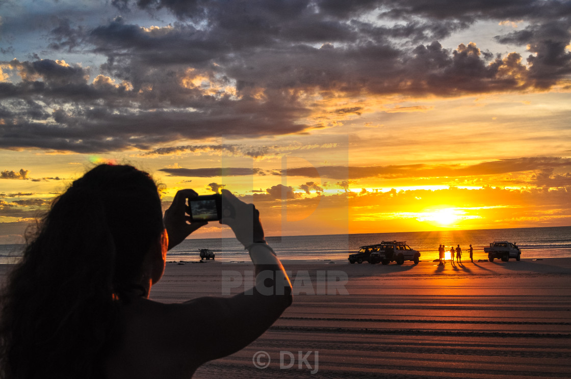 """Photographing the sunset"" stock image"