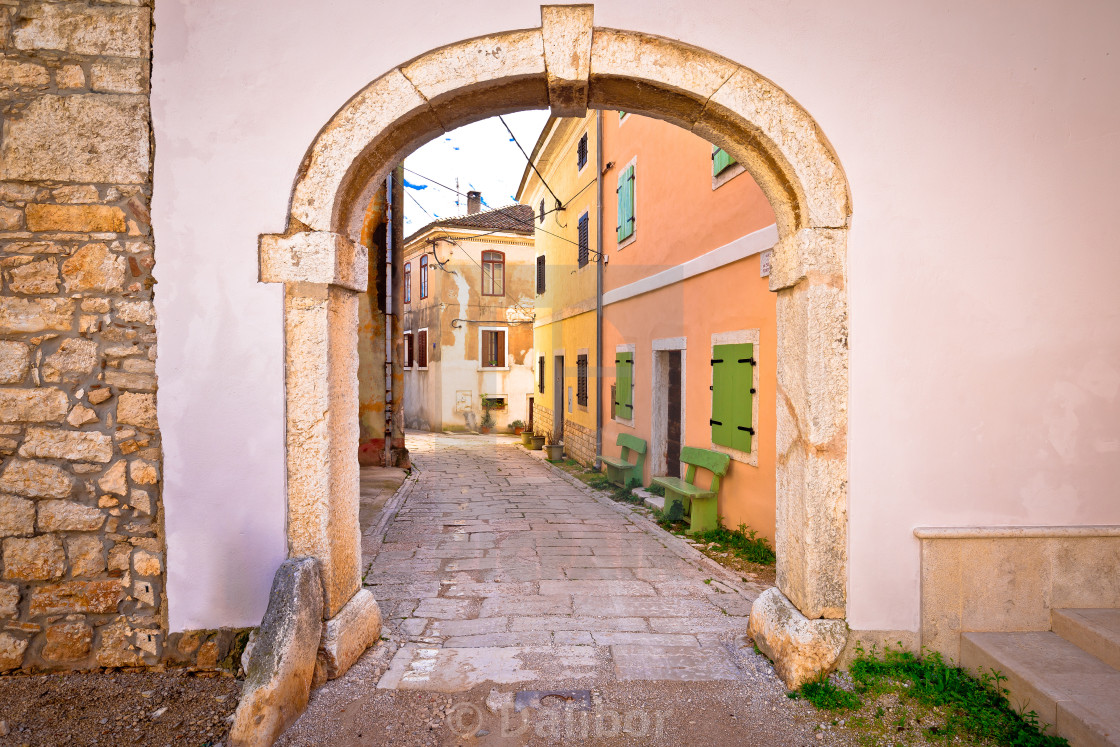 """Town of Visnjan old stone gate and street"" stock image"