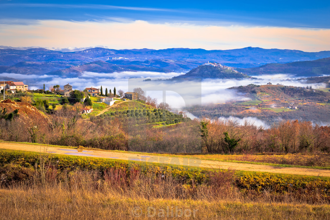 """Idyllic landscape of inland Istria in fog view"" stock image"