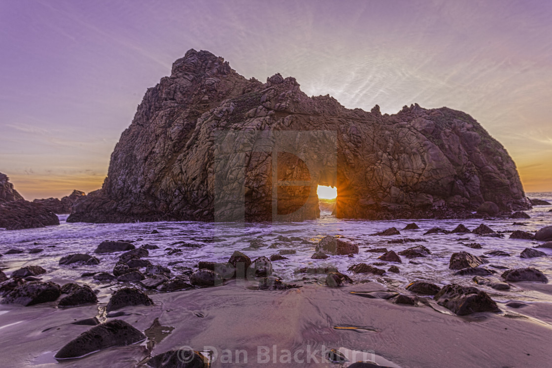 """Setting Sun Brightens Keyhole Arch in Big Sur"" stock image"