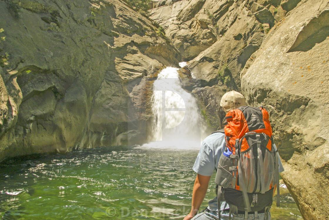 """""""Young Backpacker With Waterfall"""" stock image"""