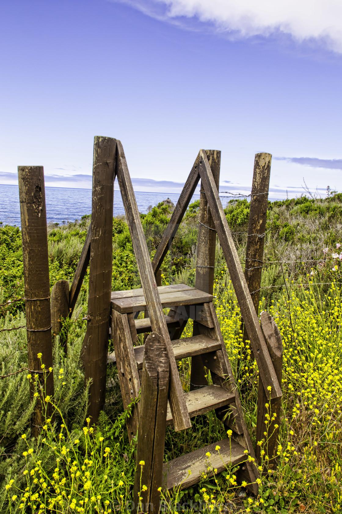 """Wooden Steps Over Fence in Big Sur"" stock image"