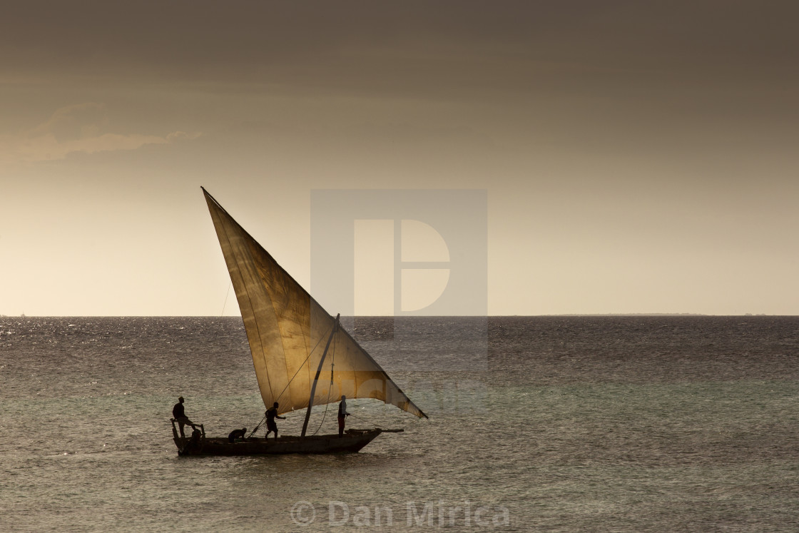 """Dhow wooden fisher boat on the Indian Ocean near Zanzibar, Tanzania"" stock image"