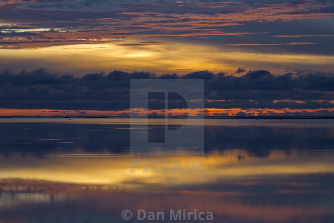 """Early morning, sunrise over sea with beautiful and colorful clouds and..."" stock image"