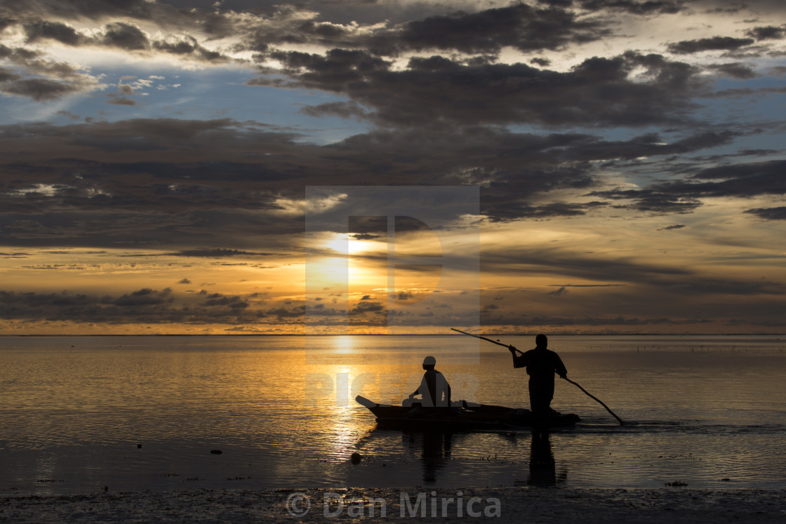"""""""Fishermen going on ocean on traditional fishing boat in Zanzibar with storm..."""" stock image"""