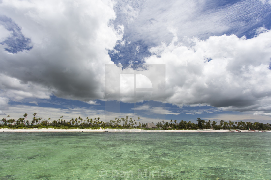 """""""Beach of Zanzibar with white clouds and colorful water"""" stock image"""