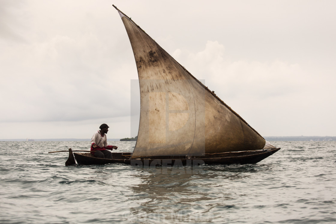 """""""Editorial use only. Unkwon man fishing on his boat. People in Africa face..."""" stock image"""