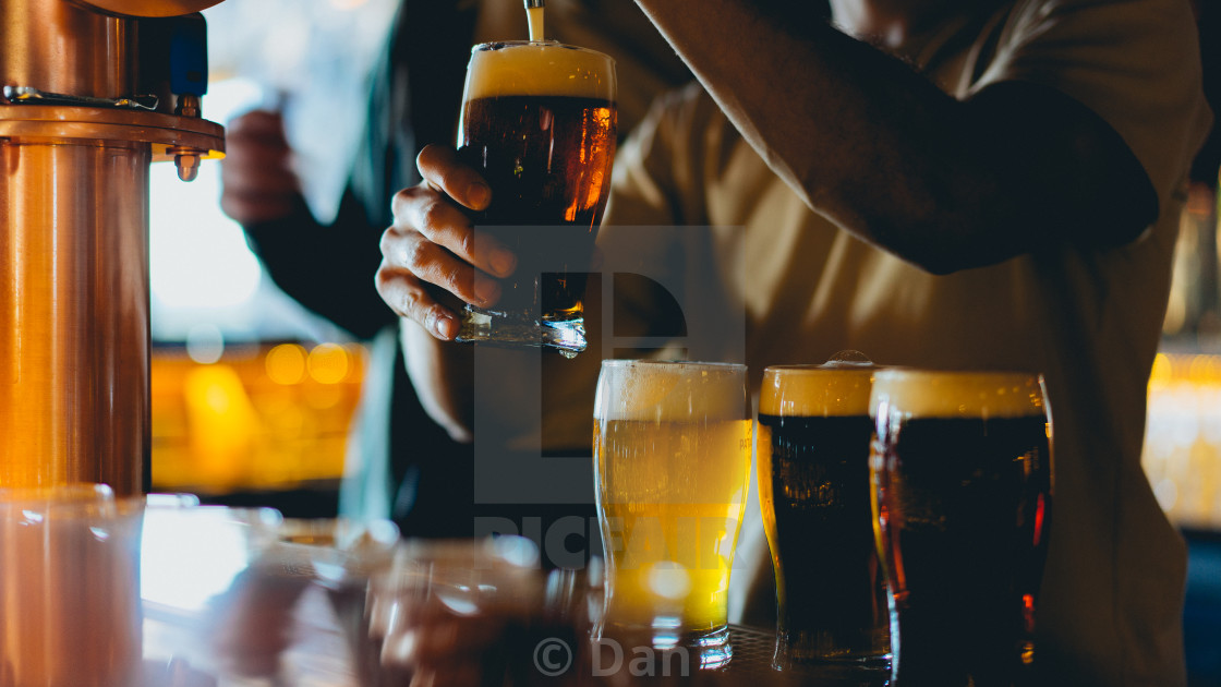 """Pouring beer at a bar"" stock image"