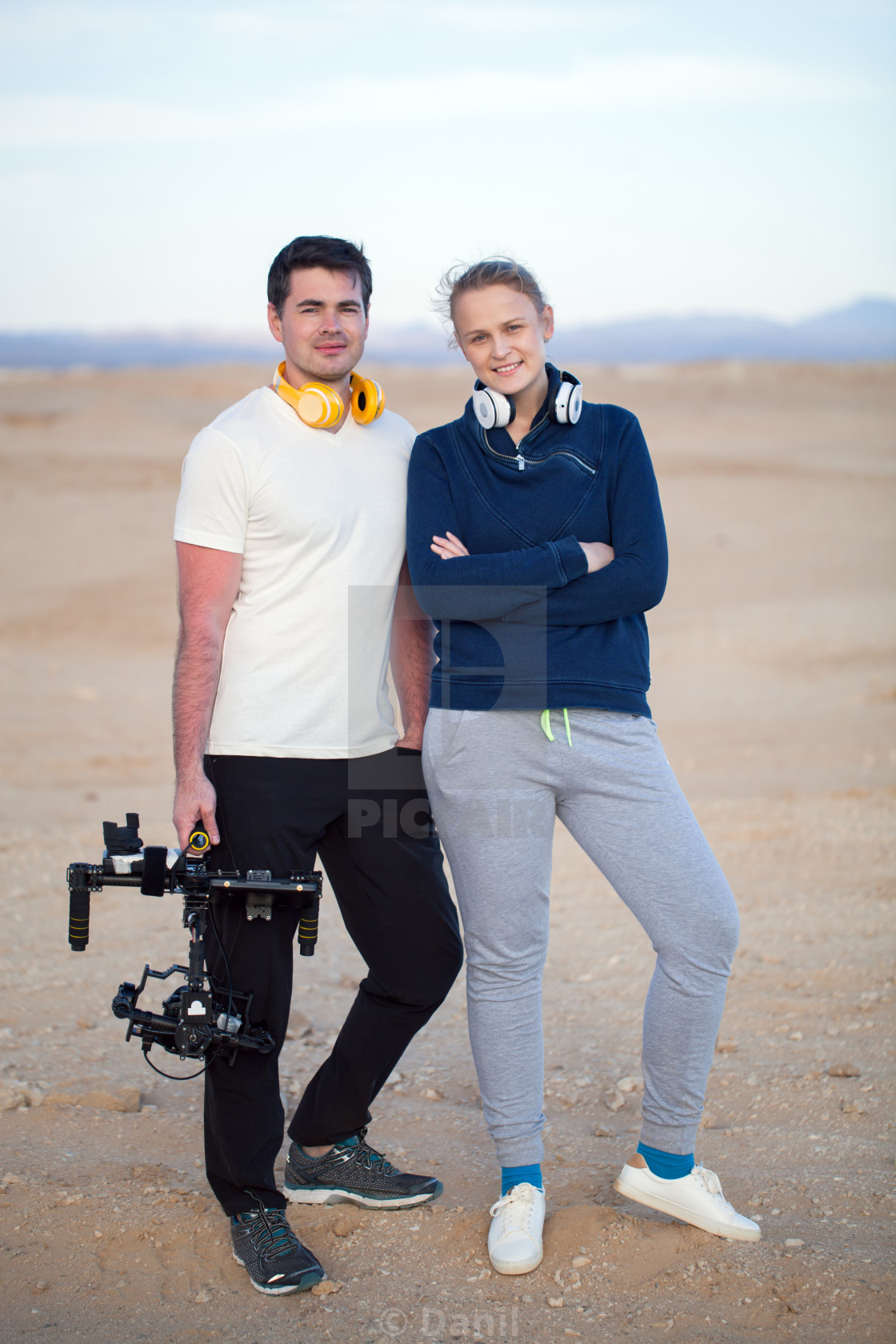 """Young people with steadycam on the beach"" stock image"
