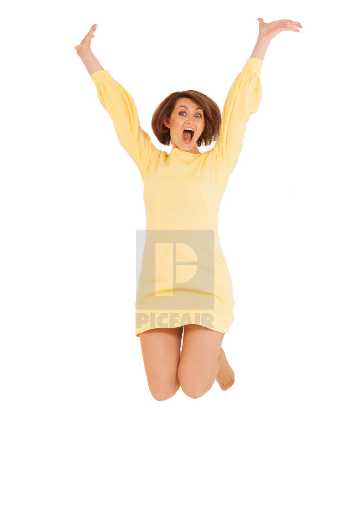 """Adult woman in yellow dress jumping"" stock image"
