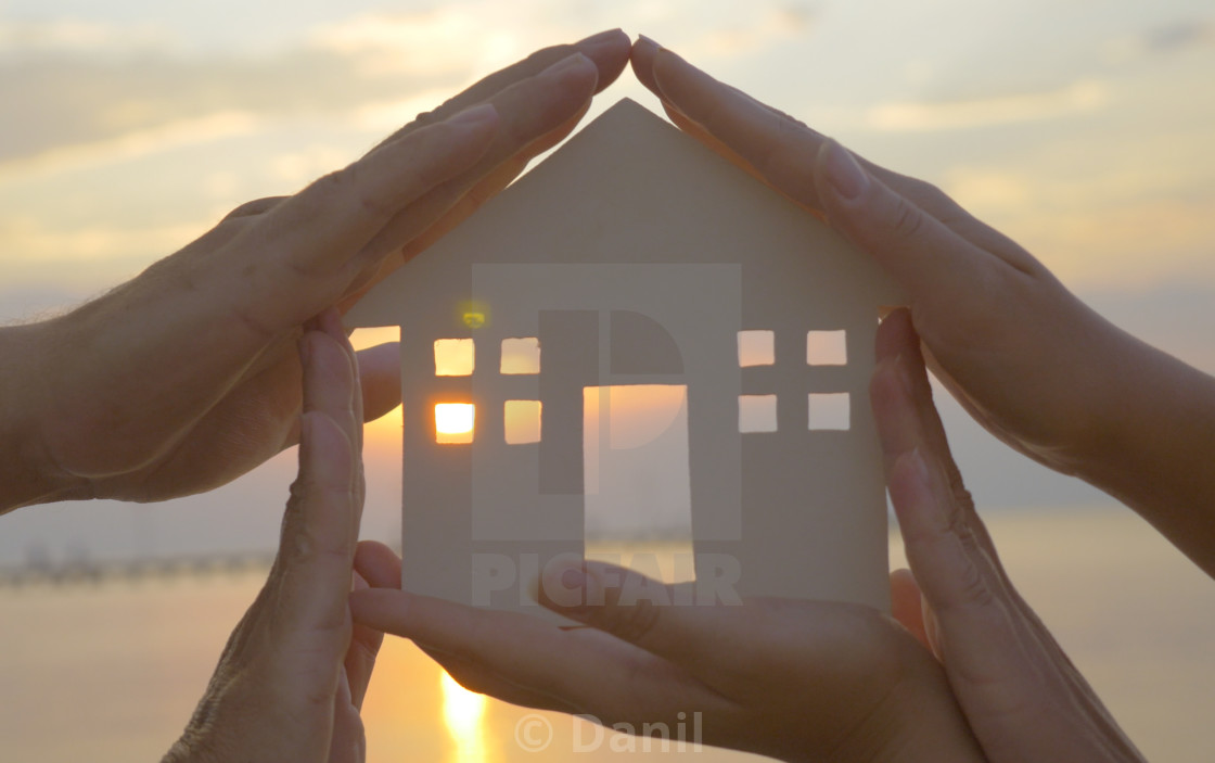 """Hands on cut out house diagram"" stock image"