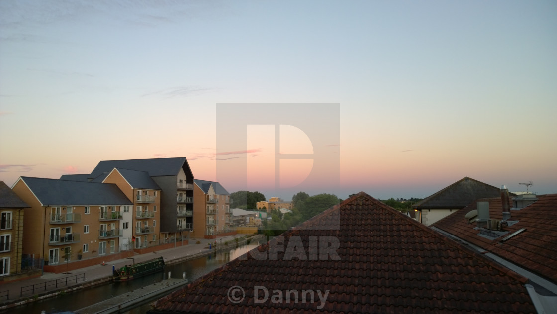 """""""Beautiful sunset over a canal and rooftops"""" stock image"""