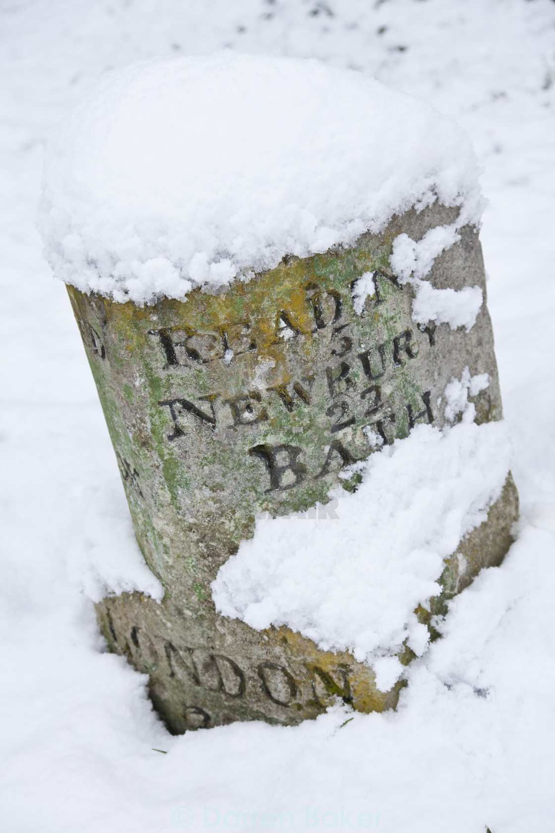 """""""Vintage British Road Sign Covered In Winter Snow"""" stock image"""