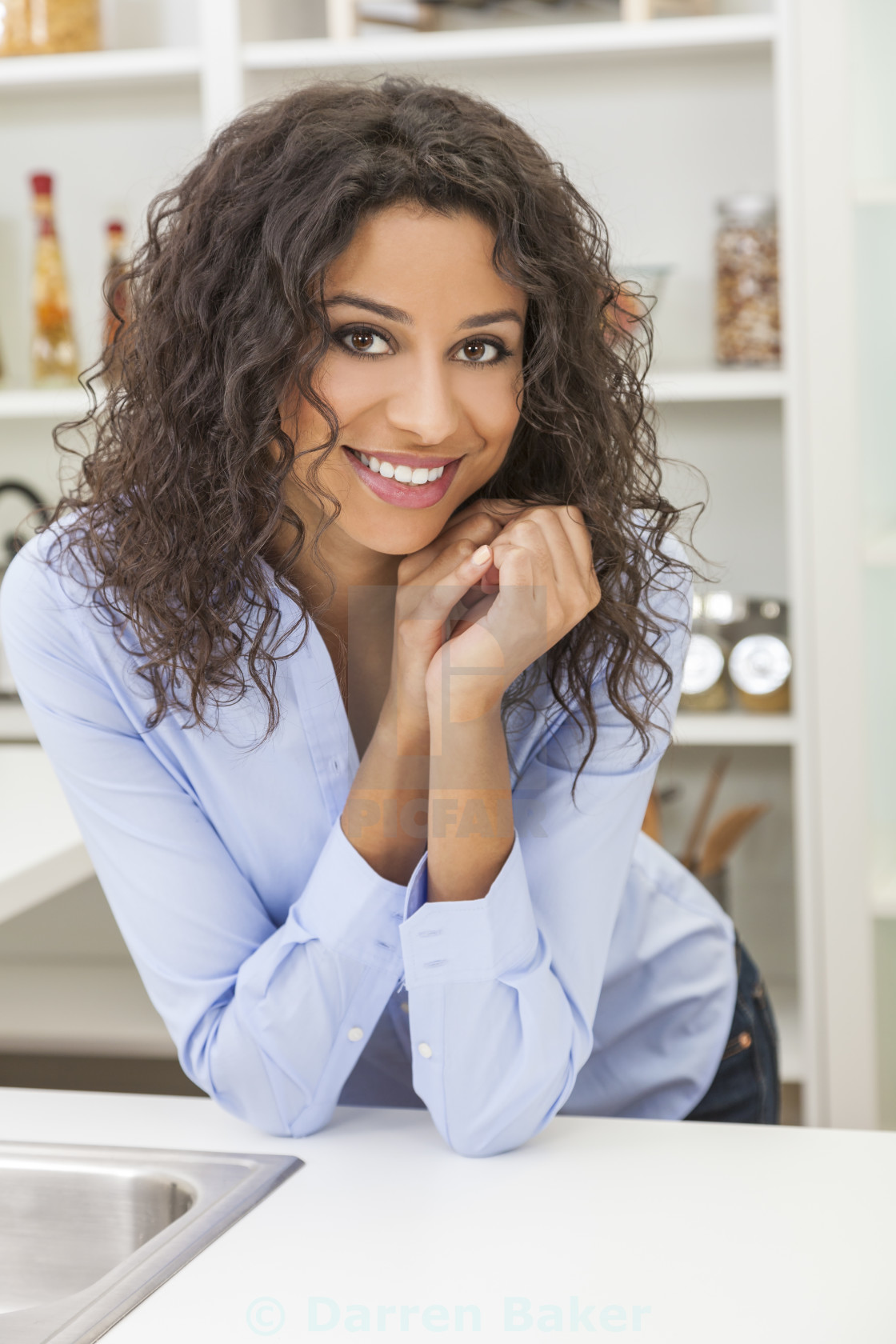 """""""Young Woman Perfect Teeth and Smile in Kitchen"""" stock image"""