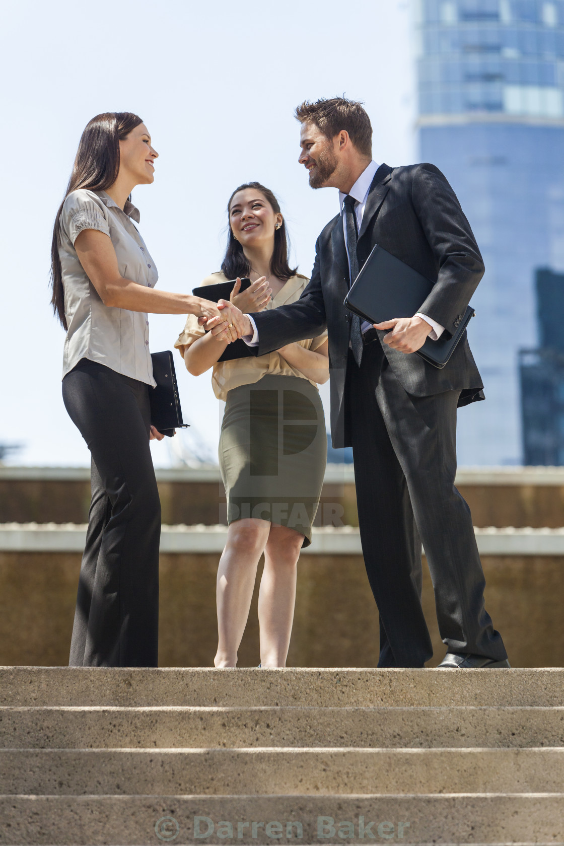 """City Business Man Woman Team Shaking Hands"" stock image"