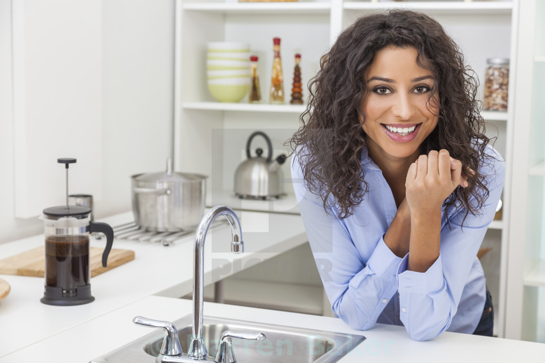 """Young Woman Perfect Teeth and Smile in Kitchen"" stock image"