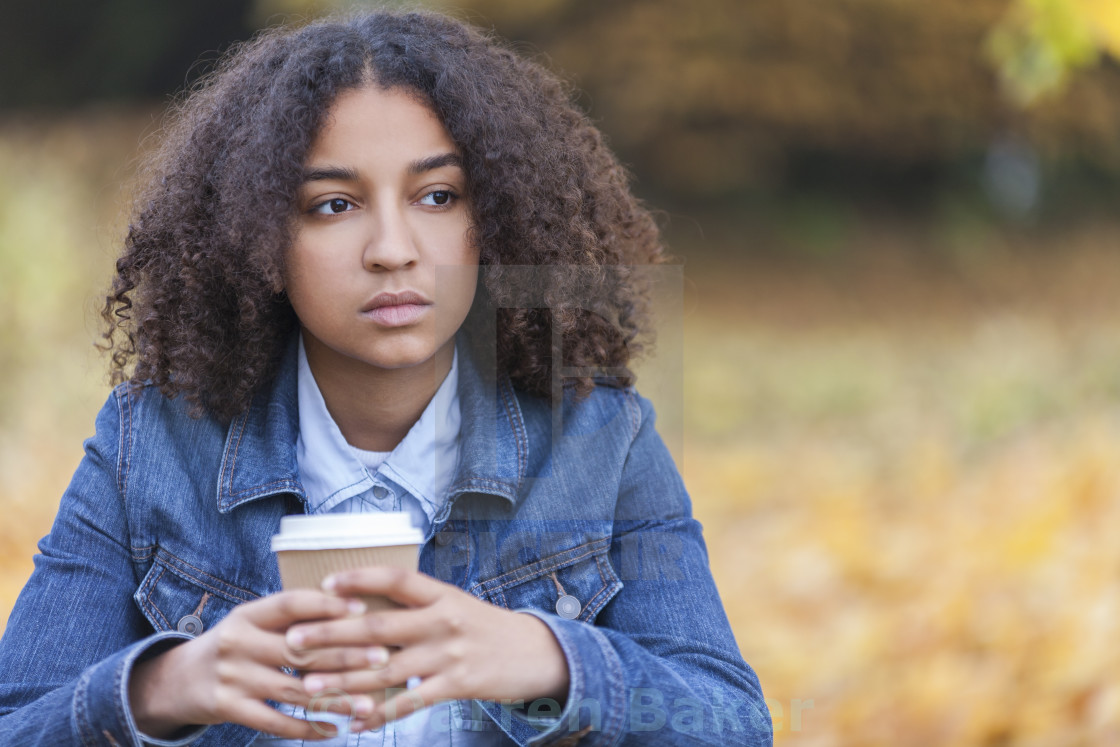 """Sad Mixed Race African American Teenager Woman"" stock image"