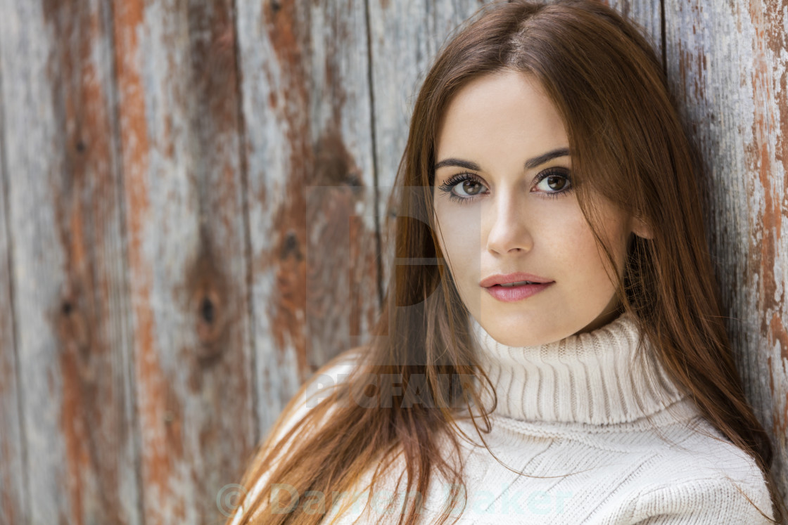"""Young Woman With Red Hair Wearing Jumper"" stock image"