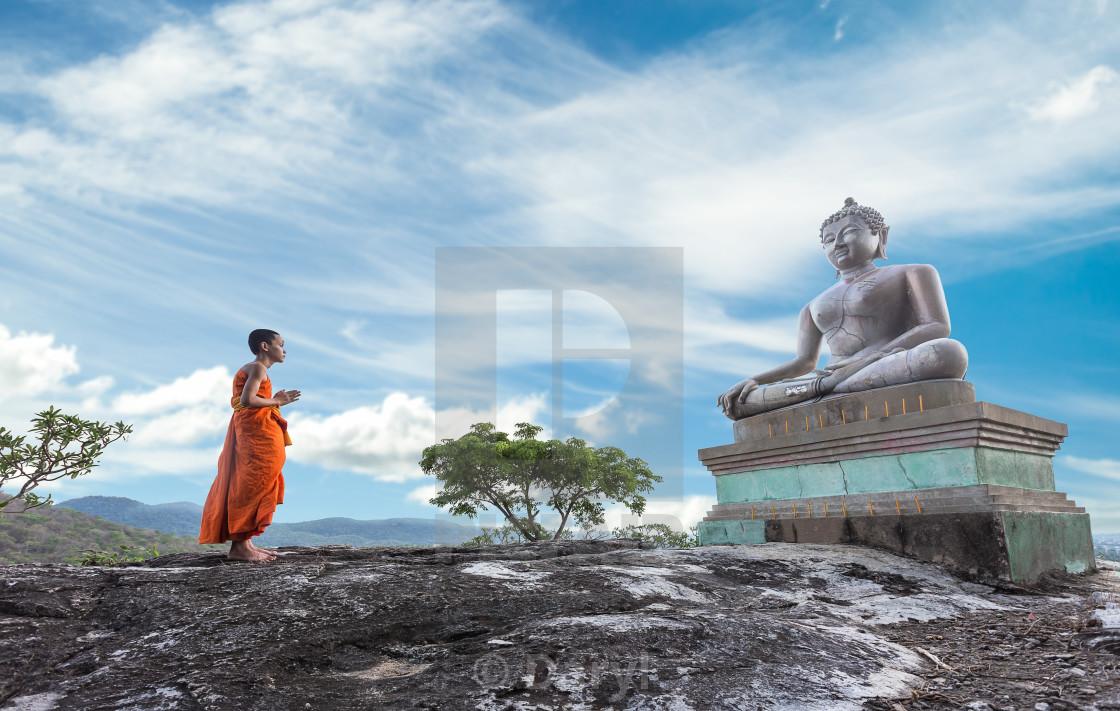 """Novice Monk praying to the Buddha"" stock image"