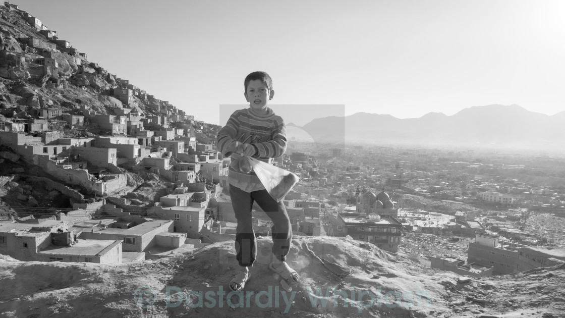 """Boy on the hill"" stock image"