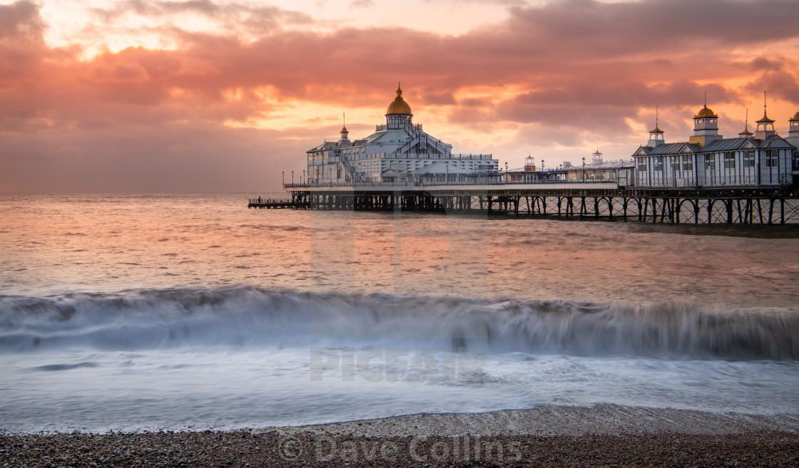 """Sunrise, Eastbourne Pier, Sussex, England"" stock image"
