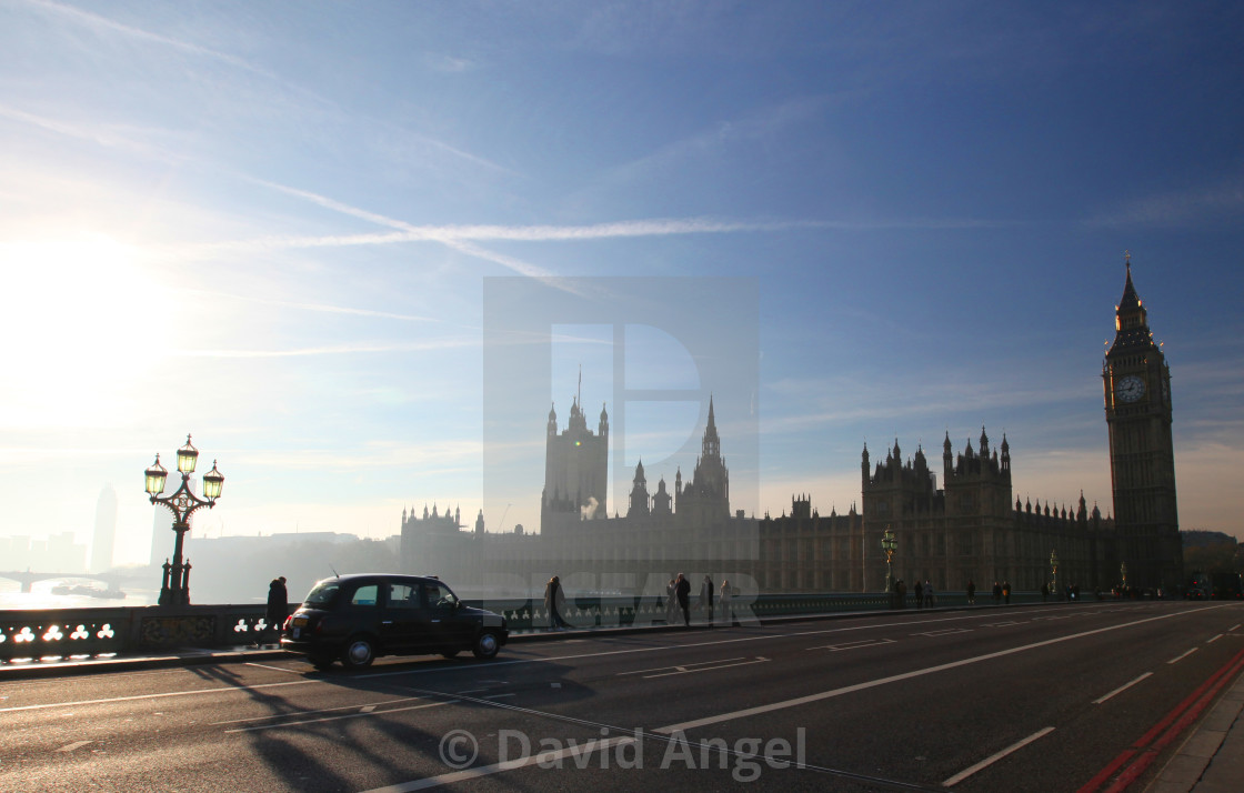 """Early morning taxi over Westminster Bridge"" stock image"