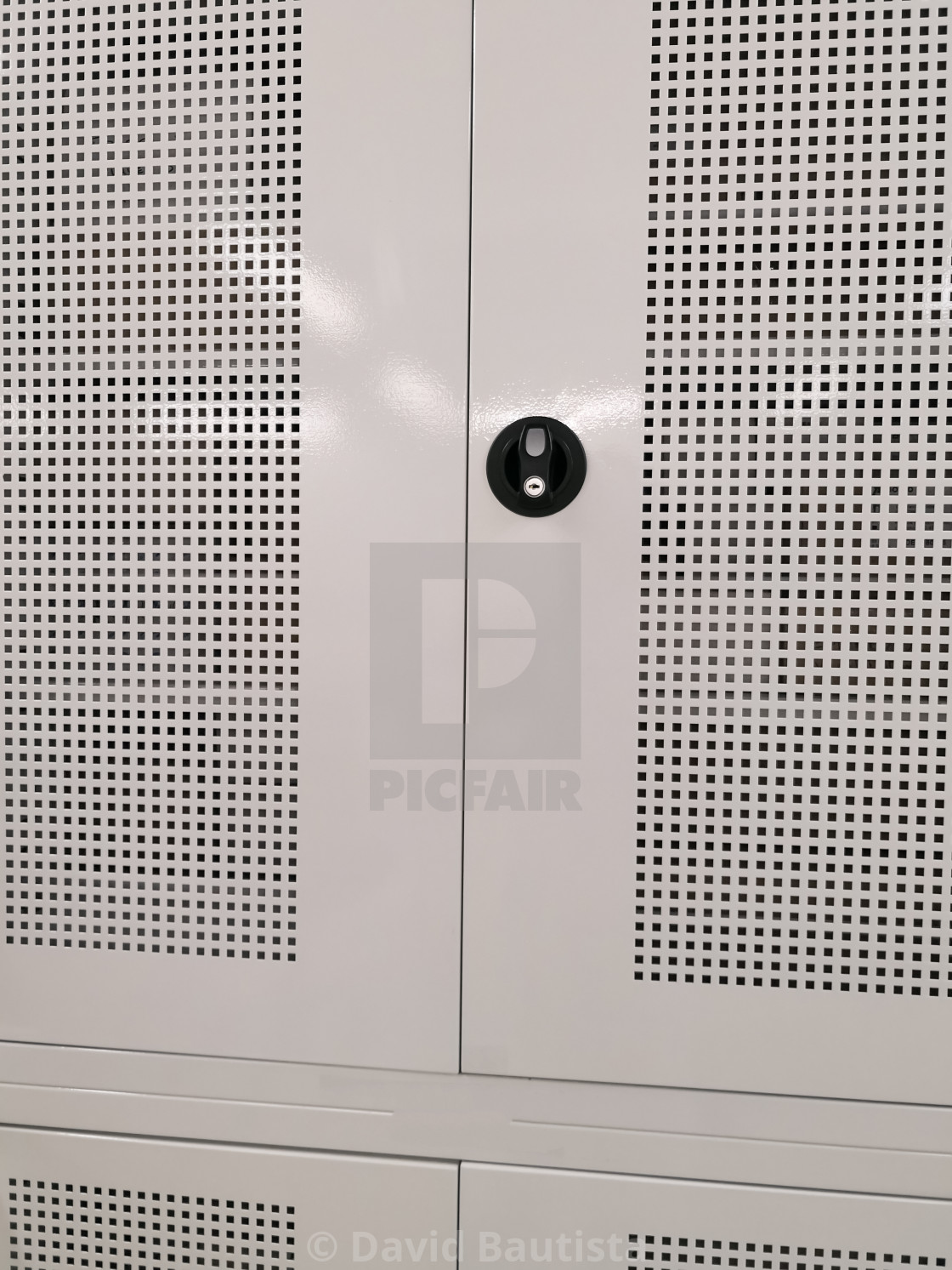 Front view of a locker with mesh grid and a black safety