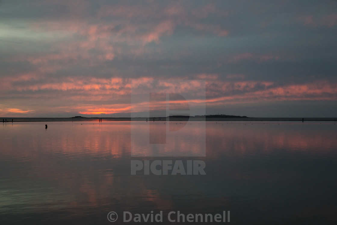 """Hilbre Island Red Sky Sunset"" stock image"