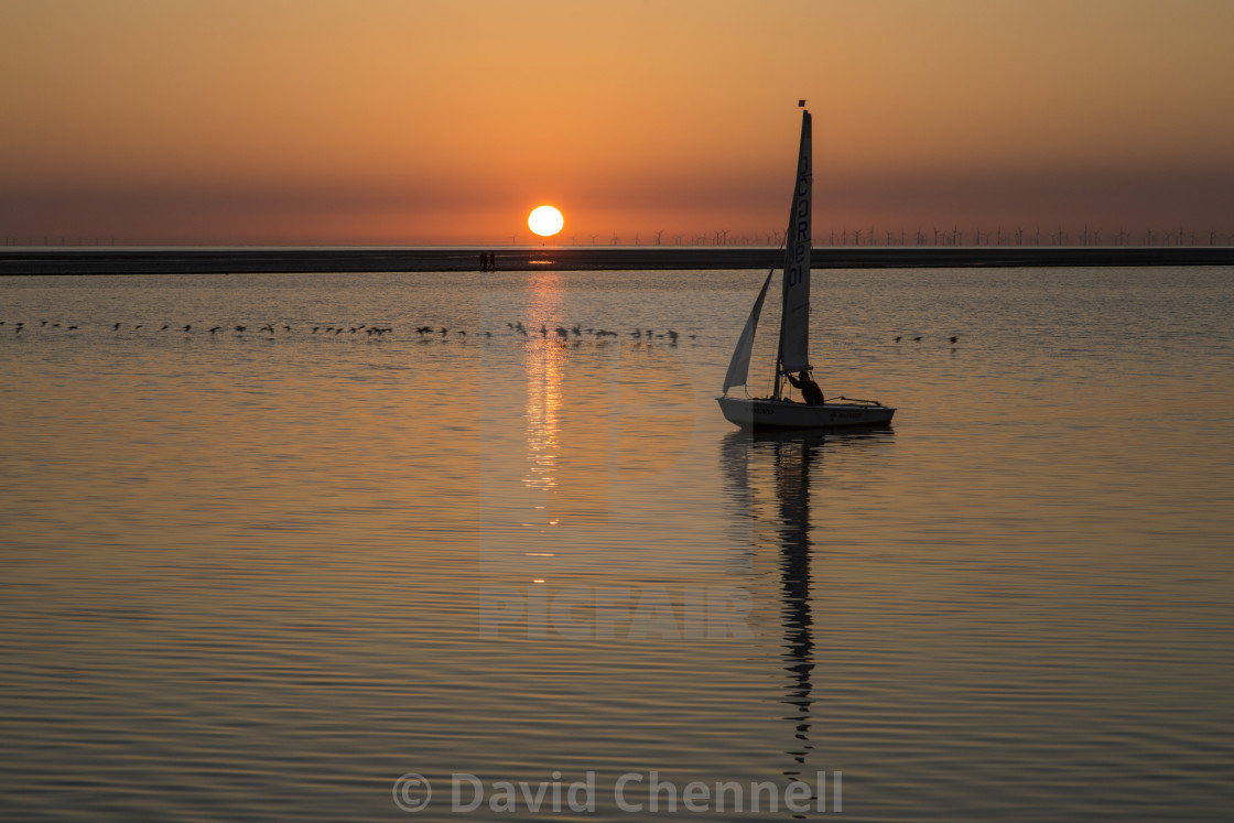 """Sunset Silhouette Sailing"" stock image"