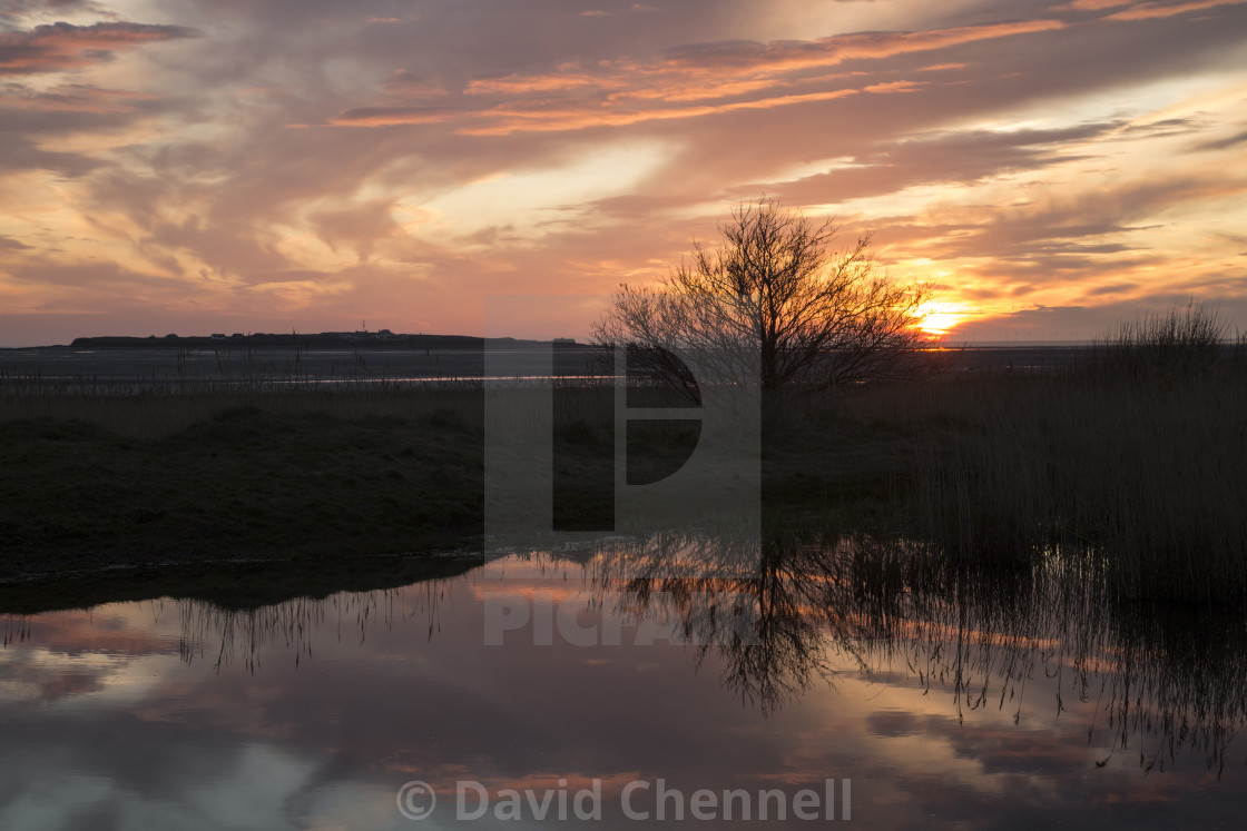"""Hilbre Island Sunset Silhouette Reflection"" stock image"