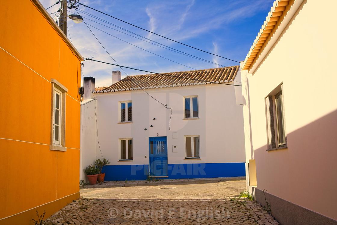 """Quiet streets in the warm Portuguese sunshine in the village of Vila do Bispo in the Algarve district."" stock image"