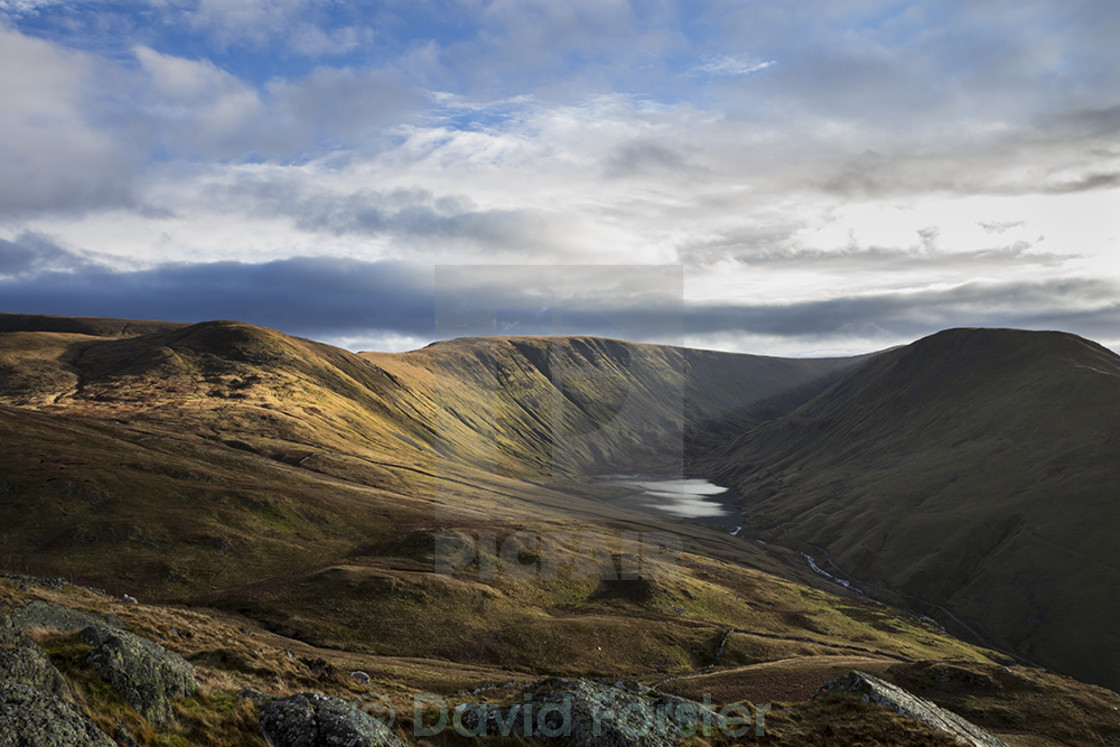 """""""Hayswater Tarn and the Mountains of The Knott and High Street Illuminated by Afternoon Light Viewed from Satura Crag Lake District Cumbria UK"""" stock image"""