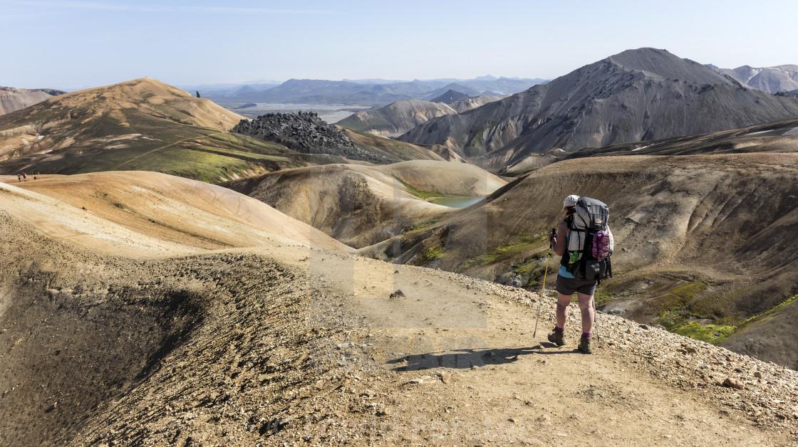 """Hiker on the Laugavegur Hiking Trail, Landmannalaugar, Iceland."" stock image"