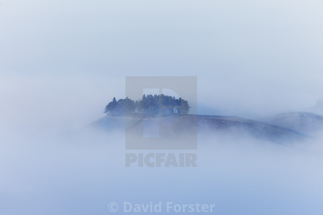 """Mist surrounding the Ancient Burial Mound of Kirkcarrion"" stock image"