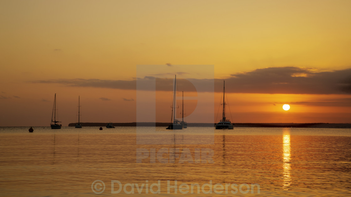 """Sailing Boats At Sunset"" stock image"