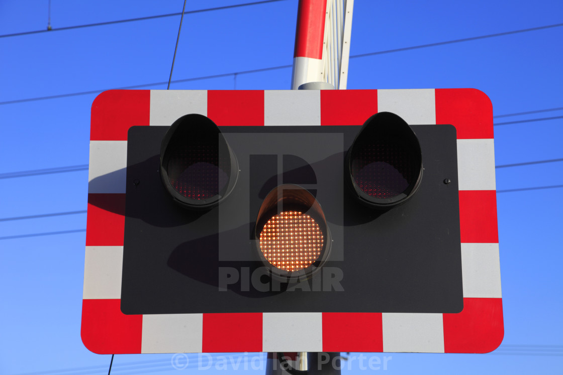 """Amber Warning light at an unmanned Level crossing, East Coast Main Line..."" stock image"