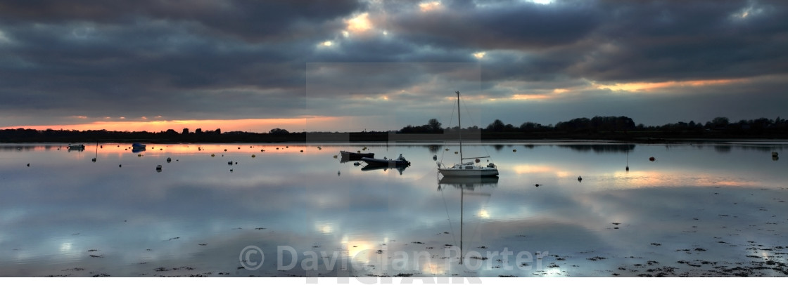 Dusk colours over Bosham boating Channel, West Sussex County