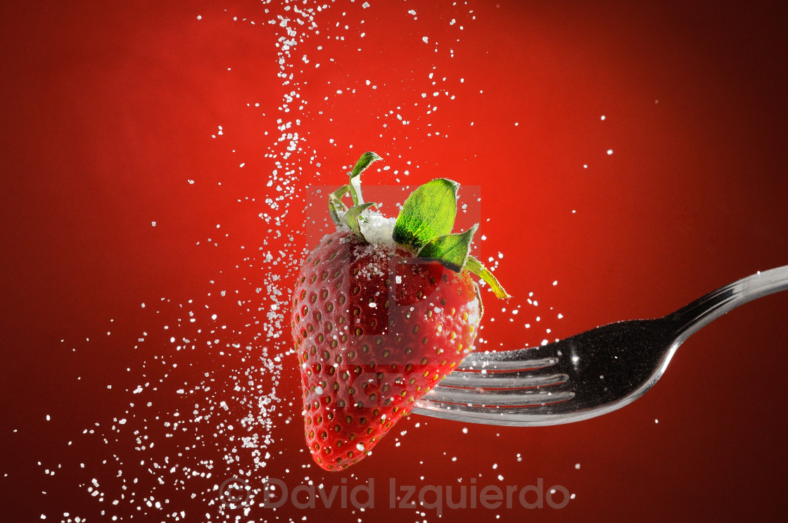 """Strawberry on a fork punctured falling sugar detail"" stock image"