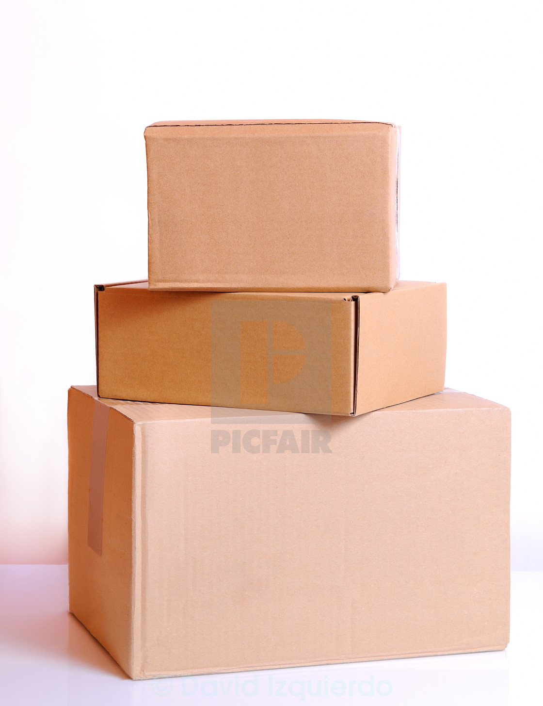 """Three cardboard boxes isolated"" stock image"